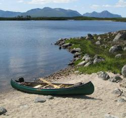 Canoe on beach of Loch Laidon above Rannoch in Scotland